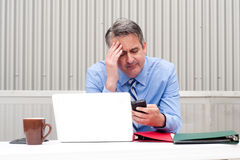 Businessman under stress, fatigue and headache Royalty Free Stock Photos