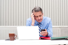 Businessman under stress, fatigue and headache Royalty Free Stock Images