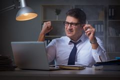 The businessman under stress smoking in office Royalty Free Stock Photo