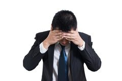 Businessman under stressed with a headache isolated on white background. Disappointed gloomy young man resting his head on hand. Having suicidal thoughts. Human Royalty Free Stock Photos