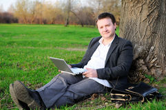 Businessman under a tree Stock Photography