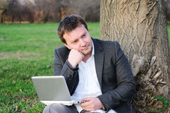 Businessman under a tree Royalty Free Stock Photography