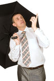 The businessman under an umbrella Royalty Free Stock Photos