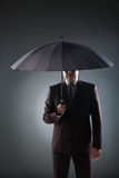 Businessman under umbrella Royalty Free Stock Images