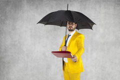 Businessman under the umbrella protects data Royalty Free Stock Photo