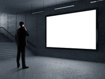 Businessman in underground passage. Businessman standing in underground passage with phone Royalty Free Stock Photos