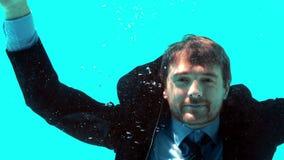 Businessman underwater stock video footage