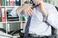 Businessman undoing his tie Royalty Free Stock Photo