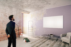 Businessman in unfinished room Stock Images
