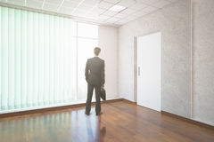Businessman in unfurnished interior Stock Image