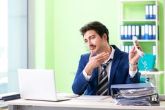 The businessman unhappy with excessive work sitting in the office stock photos