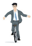 Businessman on unicycle Royalty Free Stock Image
