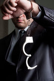 Businessman with unlocked handcuffs. Freedom - businessman with unlocked handcuffs on hand Royalty Free Stock Image