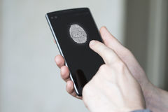 Businessman unlocked phone fingerprint. Button Stock Image