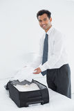 Businessman unpacking luggage at a hotel bedroom Royalty Free Stock Images