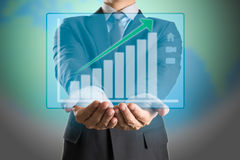 Businessman with up trend investment graph Royalty Free Stock Photography