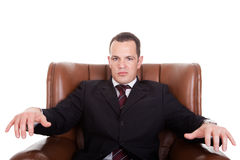 Businessman upset seated on a chair Royalty Free Stock Photography