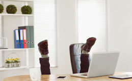 Businessman upside down at his desk. In his office Royalty Free Stock Photography