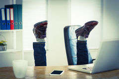 Businessman upside down at his desk. In his office Royalty Free Stock Image