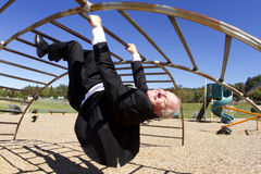 Businessman Upside Down in Playground Royalty Free Stock Photo