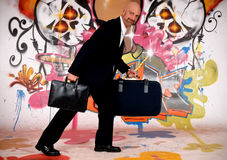 Businessman, urban graffiti Stock Photos