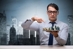 The businessman in urban planning concept Stock Images