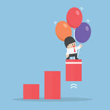 Businessman use balloon to pulled up the graph royalty free illustration