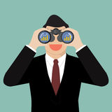 Businessman use binoculars looking for business future Stock Photos