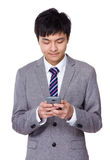 Businessman use the cell phone Royalty Free Stock Image