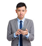 Businessman use cellphone Stock Images