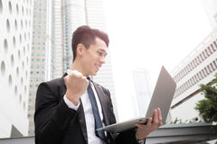 Businessman use computer in honkong. Asian stock photos