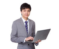 Businessman use of the computer Royalty Free Stock Image