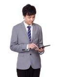 Businessman use of digital tablet Stock Photo