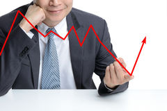 Businessman use finger to change from downing to be rising arrow stock image