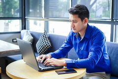 Businessman use labtop in the coffee shop and tablet is on the table stock photos