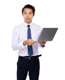 Businessman use of laptop computer Royalty Free Stock Photo