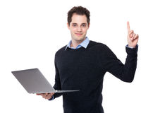 Businessman use of laptop and finger point up Royalty Free Stock Image