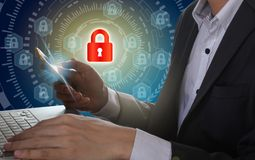 Businessman use Laptop and smartphone with padlock and circle te stock image