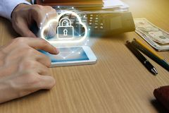 Businessman use Laptop and smartphone with padlock and cloud tec Royalty Free Stock Photo