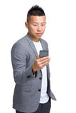 Businessman use mobile phone Stock Image