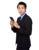 Businessman use of mobile phone Stock Photography