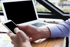 Businessman use mobile phone at workplace. man texting message o. Businessman use mobile phone at workplace. young man texting message on smart phone at office Stock Images