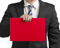 Businessman use one hand to hold a blank red board in white back. Ground close up Royalty Free Stock Photo