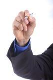 Businessman use pen writing something Stock Images