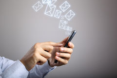 Businessman Use Smart Phone With Email Icons Stock Photo