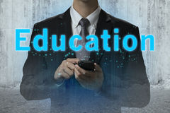 Businessman use smart phone for learning education Royalty Free Stock Photography