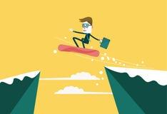 Businessman use snowboard jumping through the gap. Stock Photo