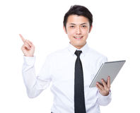 Businessman use of tablet and finger point out some idea Royalty Free Stock Image