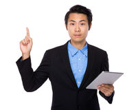 Businessman use tablet and finger point up Royalty Free Stock Images