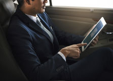 Businessman Use Tablet Inside Car Stock Photography